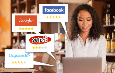 Image showing a business owner working on a laptop and showing the logos from the online review websites Google, Facebook, Yelp and Citysearch.